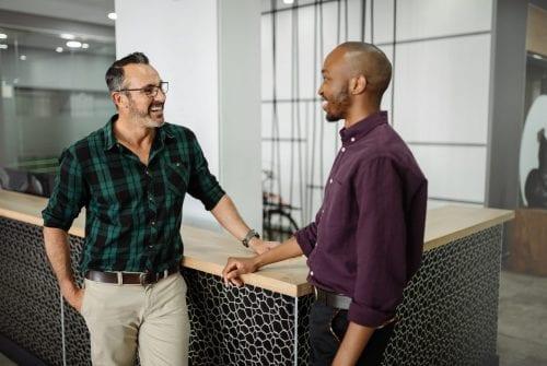 Two adult men talking