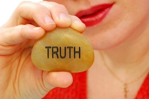 Women Holding Truth Stone